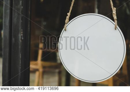 Ad. Blank Vintage Wooden Sign Board Hanging On Glass Door In Modern Cafe Restaurant, Copy Space For