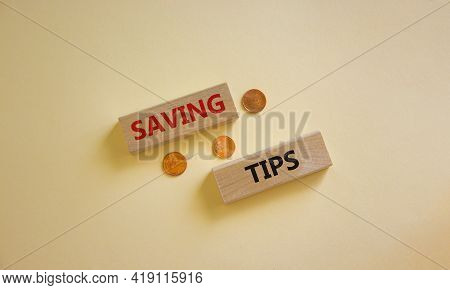 Saving Tips Symbol. Wooden Blocks With Words 'saving Tips' On Beautiful White Background. Metallic C