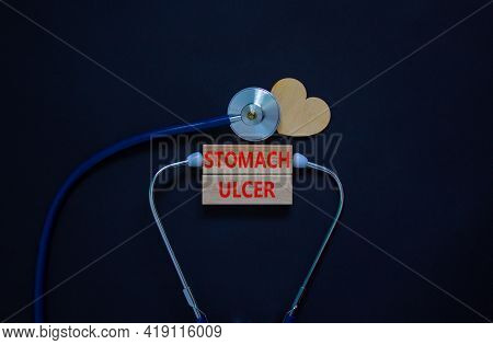 Stomach Ulcer Symbol. Wooden Blocks With Words 'stomach Ulcer' And Stethoscope On Beautiful Black Ba