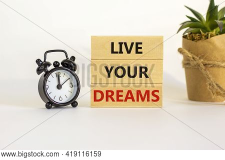 Live Your Dreams Symbol. Wooden Blocks With Words 'live Your Dreams'. Beautiful White Background, Bl