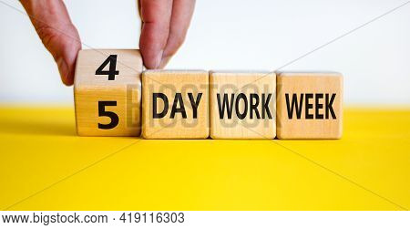 4 Or 5 Day Work Week Symbol. Businessman Turns The Cube And Changes Words '5 Day Work Week' To '4 Da
