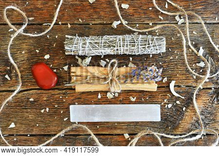 A Top View Image Of Healing Smudge Bundles With Selenite And Red Jasper Crystals On A Dark Wooden Ta