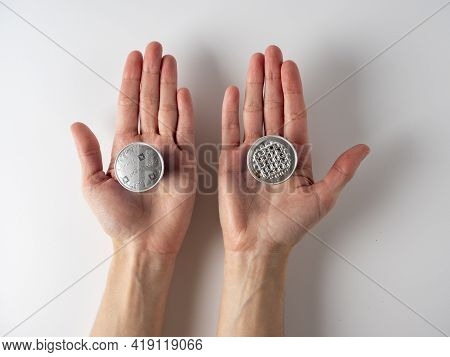 I10.03.2021 Russia, Moscow. N His Hands Are Two Aluminum Capsules With Ground Nespresso Coffee . One
