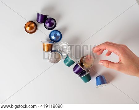 10.03.2021 Russia, Moscow.colored Aluminum Capsules With Nespresso Coffee Are Laid Out On A White Ba