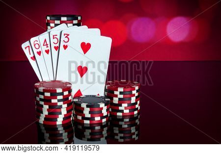 Poker Cards With A Straight Flush Combination. Close-up Of Playing Cards And Chips In Poker Club. Fr