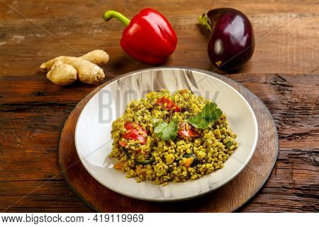 Food For Suhoor In Ramadan Bulgur Post With Vegetables In A Plate On A Wooden Table Next To Vegetabl