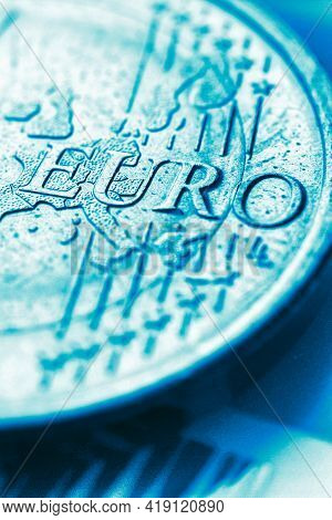 Fragment Of A Coin Of 1 One Euro. In Focus Inscription With The Name Of The Eurozone Currency. Brigh