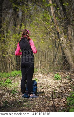 Hiker Woman With Backpack Standing On A Forest Trail. One Young Woman, Hike, In Nature. Girl Tourist