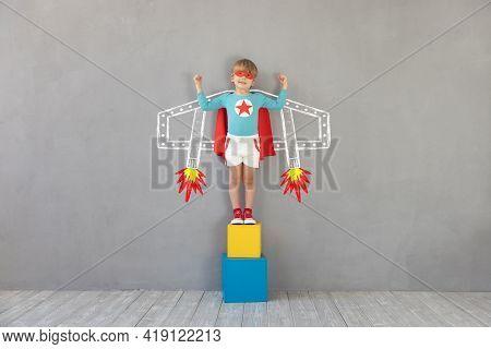 Superhero Child Playing At Home. Super Hero Kid Having Fun Indoor. Childrens Dream And Imagination C
