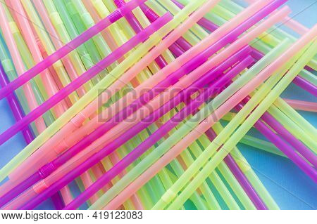 Colored Plastic Drinking Straws On A Blue Background. Say No For Plastic Drinking Straw. Zero Waste