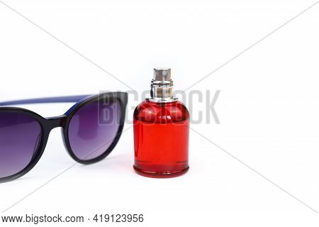 Unbranded Perfume Spray Red Bottle And Purple Sun Glasses Isolated On White Background With Copy Spa