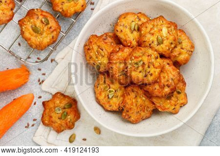 Breakfast. Freshly Baked Homemade Carrot Cookies With Flax Seed And Pumpkin Seeds Close-up. Deliciou
