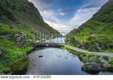 Winding Narrow Road Crossing Stone Wishing Bridge In Gap Of Dunloe, Black Valley, Macgillycuddys Ree