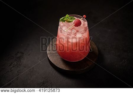 Homemade Fresh Iced Lemonade With Raspberry And Mint On A Wooden Background. Summer Healthy Drink. C