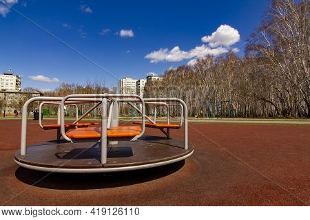 A New Carousel On A New Children's Playground In An Old Residential Area Of The City. Improvement Of