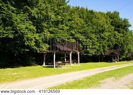 Gazebos Under The Forest Itself With Barbecue For Outdoor Recreation On Weekends