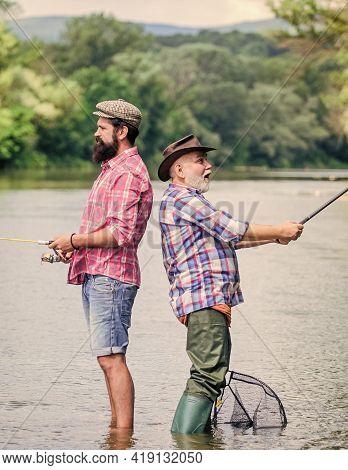 Rod And Tackle. Fisherman Fishing Equipment. Fisherman Grandpa And Mature Man Friends. Fisherman Fam