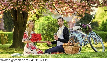 Romantic Picnic With Wine. Flowers Symbol Of Romance And Affection. Enjoying Their Perfect Date. Cou