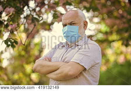 Elderly And Other Risk Groups. Pandemic Concept. Limit Risk Infection Spreading. Senior Man Wearing