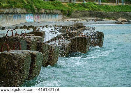 Breakwater On Beach. Ocean Beach Breakwaters. Old Concrete Blocks Campi.