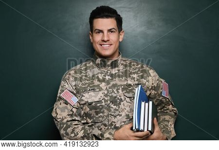 Cadet With Books Near Chalkboard. Military Education