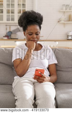 Serious Concentrated Black Woman Read Message On Smartphone. Young Pensive Female Get Bad News In Ce