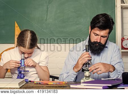 Extra Classes. Cognitive Skills Concept. Schoolgirl Likes Study With Father. Study Hard. Following E