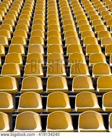 Empty Seats. Modern Stadium. Yellow Tribunes. Seats Of Tribune On Sport Stadium.