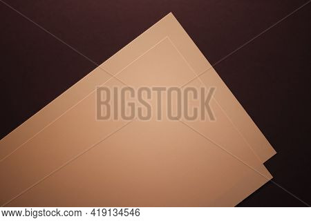 Blank A4 Paper, Beige On Dark Background As Office Stationery Flatlay, Luxury Branding Flat Lay And
