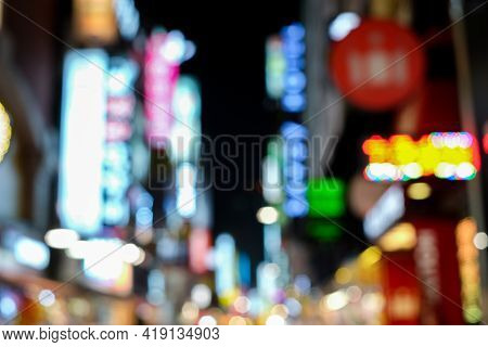 Blurred Bokeh Light Sign Board Along Street In City Nightlife Background Downtown In Seoul ,south Ko