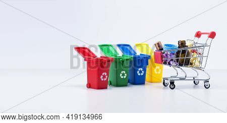 Containers For Separate Collection Garbage And Home Rubbish. Separation Of Waste On Garbage Cans For