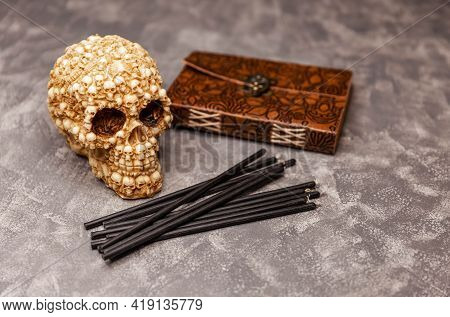 Still Life With Scary Skull, Antique Book And Black Candles. Magic Altar Of The Witch. Witchcraft Ri