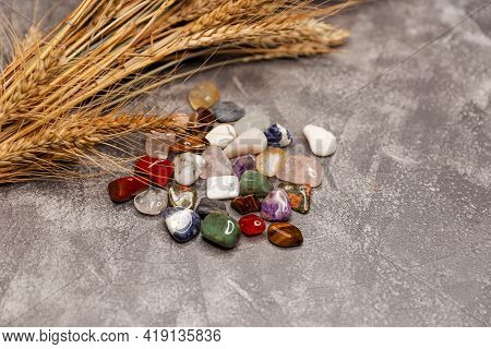 Row Of Multicoloured Healing Crystals On Grey Background. Various Healing Stones. Composition Of Eso