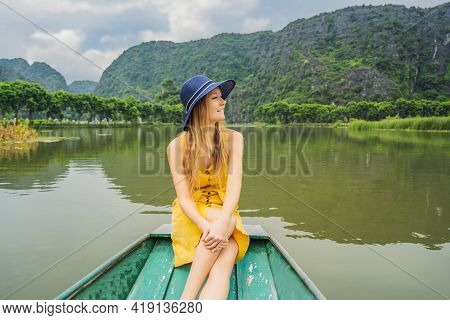 Woman Tourist In Boat On The Lake Tam Coc, Ninh Binh, Viet Nam. Its Is Unesco World Heritage Site, R