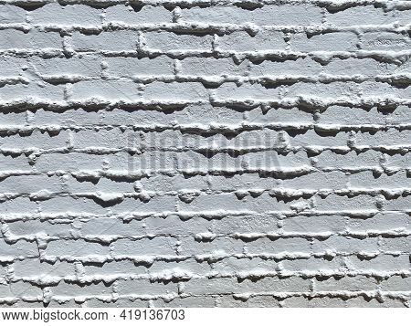 Closeup View Of Vintage Retro Brick And Mortar Wall Freshly Painted White
