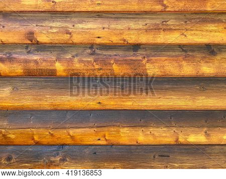 Log Cabin Building Wall Exterior Weatherproofed And Varnished Shiny