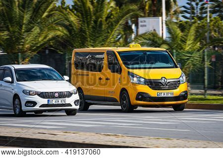 Alanya,  Turkey - April 12 2021:   Taxi Car  Is Driving Fast On The Street On A Warm Summer Day Agai