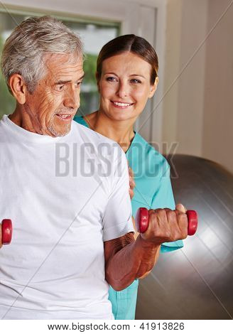 Senior man doing rehab sports in nursing home with a physiotherapist