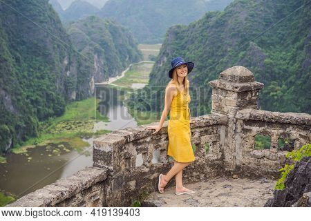 Woman Tourist On The Lake Tam Coc, Ninh Binh, Viet Nam. Its Is Unesco World Heritage Site, Renowned