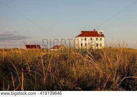 PROVINCETOWN, MASSACHUSETTS, USA -SEPTEMBER 15, 2014: Building on beach with beautiful morning sunlight.