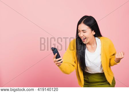 Happy Asian Portrait Beautiful Cute Young Woman Teen Smiling Excited   Using Mobile Phone Say Yes! S