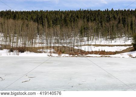 Frozen Lake Which Is A Popular Fishing Spot On An Alpine Wilderness Covered With Snow Surrounded By