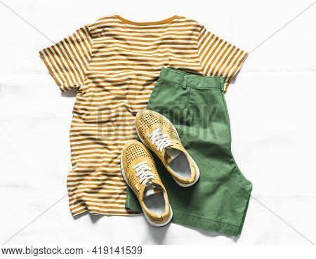 Women's Cotton Bermuda Shorts, Yellow T-shirt, White Leather Sneakers On A Light Background, Top Vie