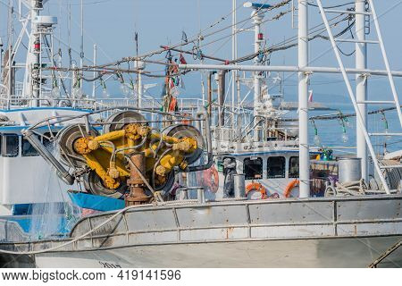 Daecheon, South Korea; April 25, 2021: Drum Winch Used With Fishing Nets On Deck Of Trawler Moored A