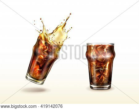 Splash Cola, Soda, Cold Tea Or Coffee With Ice Cubes. Splashing Drink In Glass Cup With Air Bubbles.