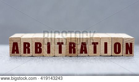 Arbitration - Word On Wooden Bars On A Gray Background