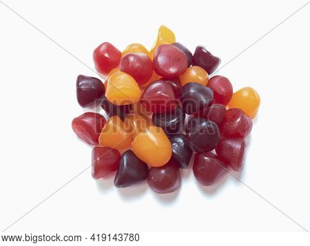 Close-up Texture Of Red, Orange And Purple Multivitamin Gummies. Healthy Lifestyle Concept.