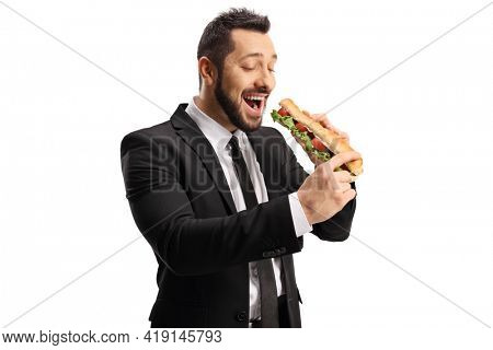 Young professional man eating a sandwich in a baguette isolated on white background