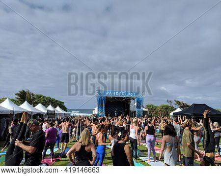 North Shore, Oahu - March 3, 2019: People Help Each Other Practice Handstand Pose At Wanderlust Mc Y