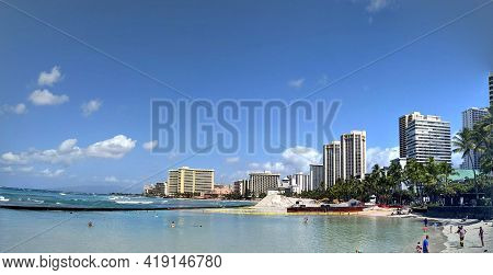 Waikiki - March 22, 2021: People Play In The Protected Water And Hang Out On The Beach With Sand Res